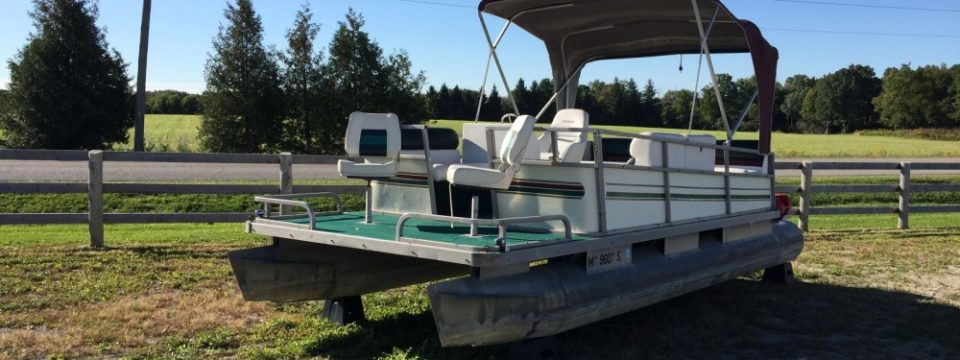 Older 22′ Pontoon  with a 25hp Mercury Motor